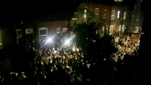 Hundreds of students having a street party near Hyde Park in Leeds (Photo: SWNS)
