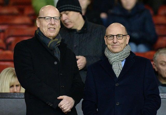 Manchester United's co-chairmen Joel Glazer and Avram Glazer (Photo by OLI SCARFF/AFP via Getty Images)