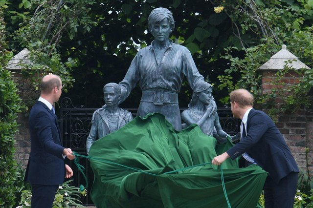 Prince William and Prince Harry unveil a statue of their mother, Princess Diana, at The Sunken Garden in Kensington Palace (AFP/Getty Images)