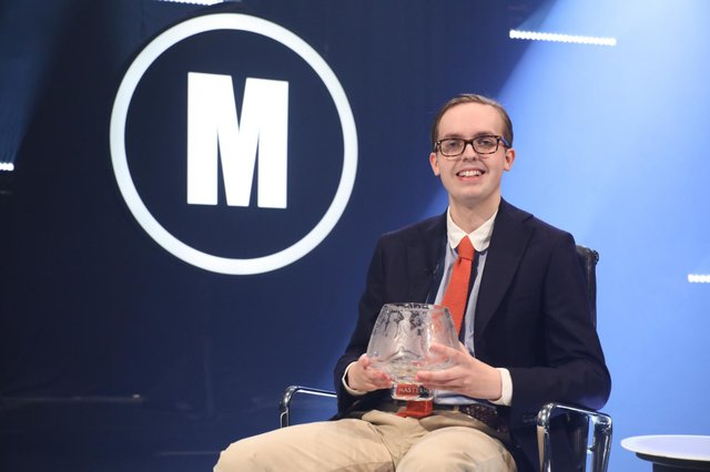 Jonathan Gibson after he became the youngest person to win BBC's Mastermind (PA Media)