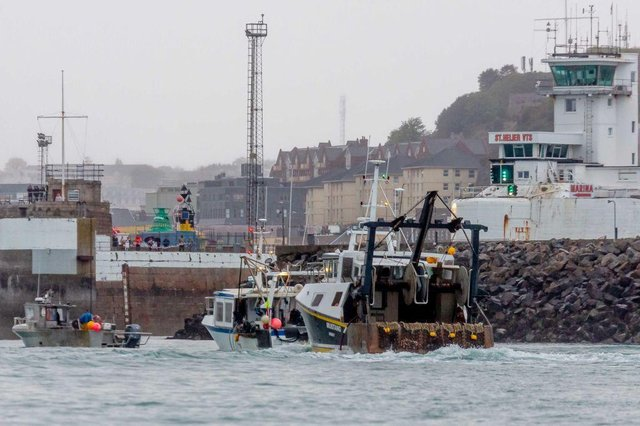 French fishing boats sail into the harbour in protest against the new fishing licences on May 6, 2021 in St Helier, Jersey.
