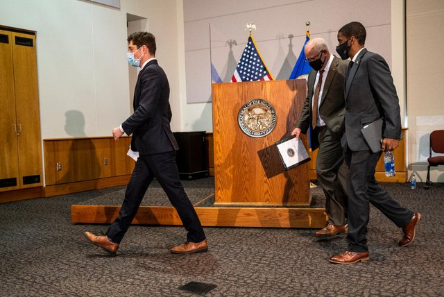 Minneapolis Mayor Jacob Frey, Minnesota Governor Tim Walz, and St. Paul Mayor Melvin Carter walk out after speaking at a press conference about public safety in Minnesota as closing statements were heard in the trial of Derek Chauvin (Getty Images)