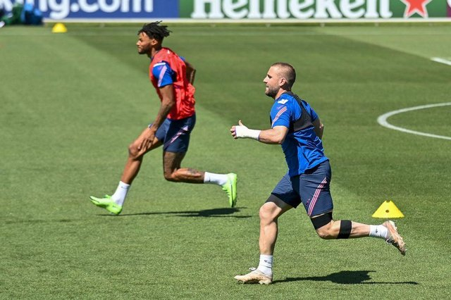 England's defenders Tyrone Mings and Luke Shaw race during a training session at the St. George's Park.