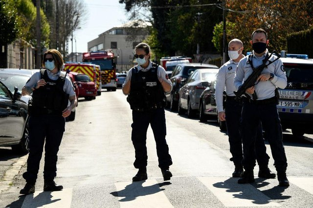 French police officials block off a street near a police station in Rambouillet, south-west of Paris, on April 23, 2021, after a woman was stabbed to death in the town (Photo by BERTRAND GUAY/AFP via Getty Images)