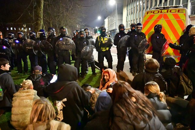 Police and protesters at College Green in Bristol where police said around 130 people had gathered earlier in the evening