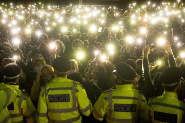 People turn on their phone torches as they gather in Clapham Common for a vigil for Sarah Everard on 13 March 2021 (Photo: Victoria Jones/PA Wire/PA Images)