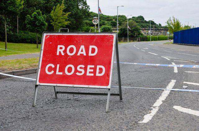 Stock image of a closed-off road following a traffic collision (Shutterstock)