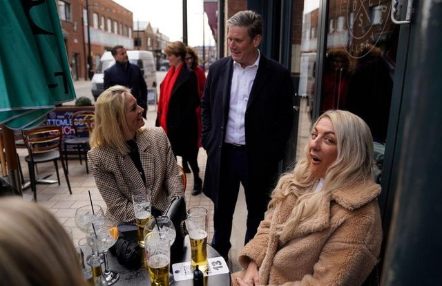 Labour leader Sir Keir Starmer talks to locals while on a walkabout in Hull during campaigning for the local and PCC elections (Photo by Owen Humphreys - Pool /Getty Images)
