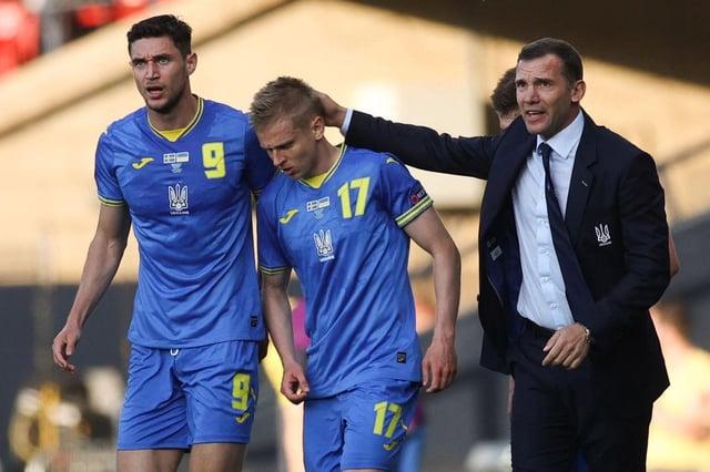 Ukraine's defender Oleksandr Zinchenko celebrates with coach Andrey Shevchenko and Yaremchuk.