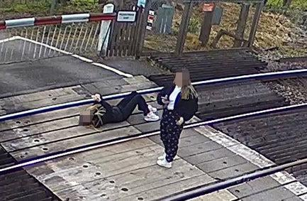 A worrying image of a girl using her phone on live train tracks has been released to warn children about the dangers (Network Rail)