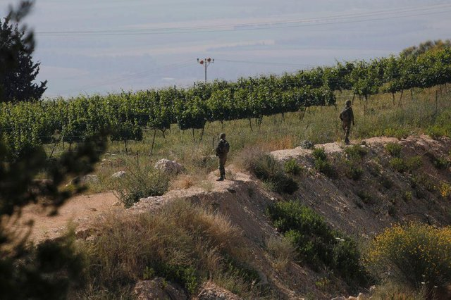 Israeli soldiers deploy in the northern Kibbutz of Misgav Am, near the border with Lebanon (Getty Images)