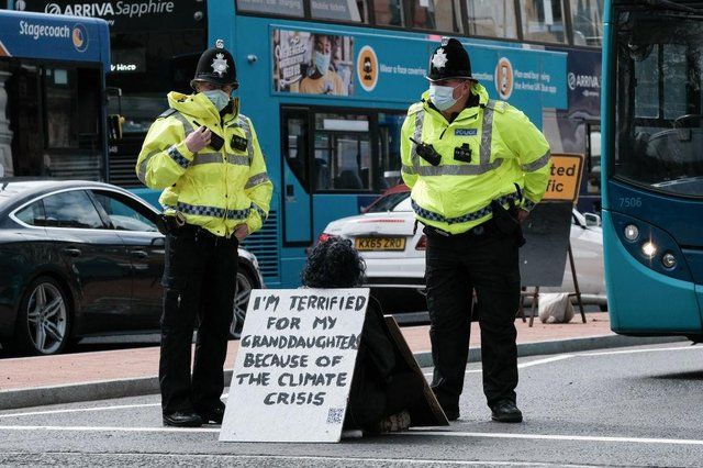 A protestor blocks a Newcastle road (Getty Images)