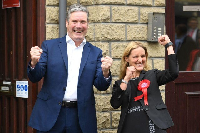 Labour Party leader Keir Starmer and Kim Leadbeater celebrate victory outside the campaign centre in Cleckheaton, West Yorkshire on July 2, 2021 (Photo by OLI SCARFF/AFP via Getty Images)