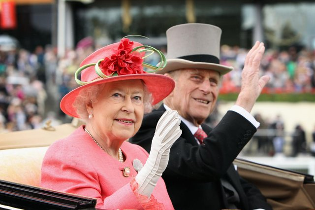 Queen Elizabeth II and Prince Philip arrive in an open carriage on Ladies Day at Royal Ascot in 2011 (Getty Images)