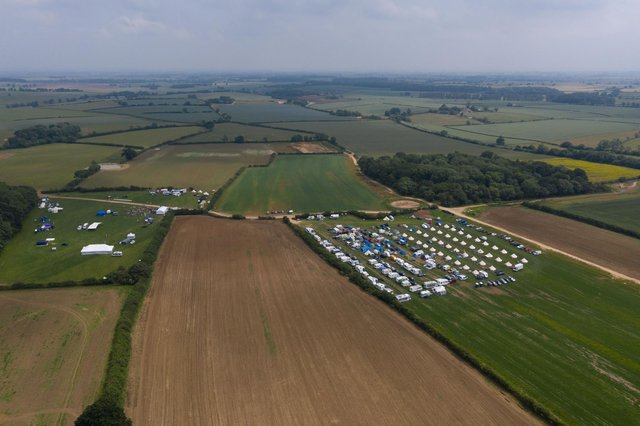 These drone images show hundreds of swingers arriving at the festival - despite organisers saying it was cancelled (Photo: SWNS)
