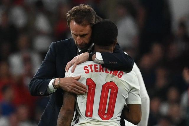Gareth Southgate embraces Raheem Sterling after the UEFA EURO 2020 final (Photo by PAUL ELLIS/POOL/AFP via Getty Images)