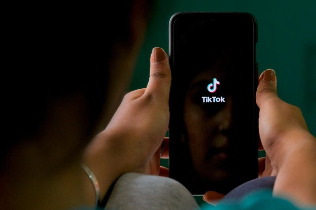 A mum has shared her concerns over graphic footage her daughter has seen on TikTok - and urges other parents to keep an eye on what their youngsters are viewing (Getty).
