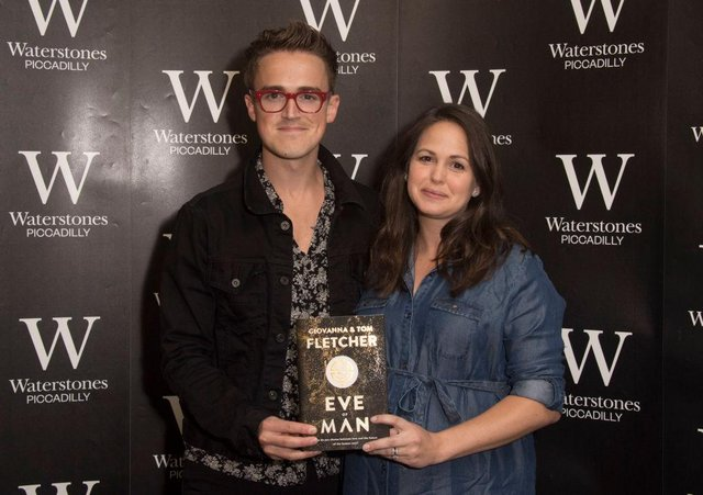 Tom and Giovanna Fletcher sign copies of their new book 'Eve Of Man' at Waterstones (Photo: Stuart C. Wilson/Getty Images)
