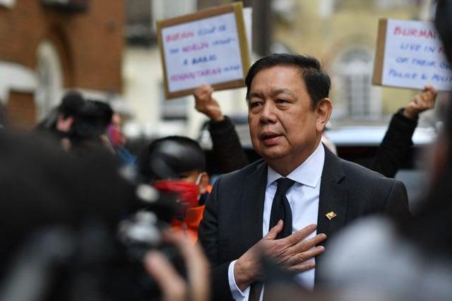 Myanmar's Ambassador to the United Kingdom, Kyaw Zwar Minn addresses the media outside the Myanmar Embassy in London on April 8, 2021.