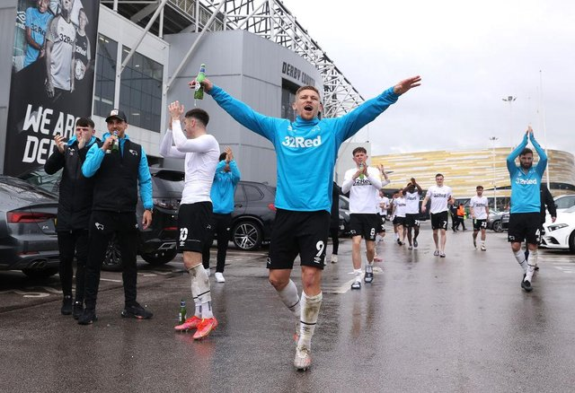 Martyn Waghorn of Derby County celebrates with fans outside the stadium as they secure safety in the Championship the Sky Bet Championship match between Derby County and Sheffield Wednesday at Pride Park Stadium.