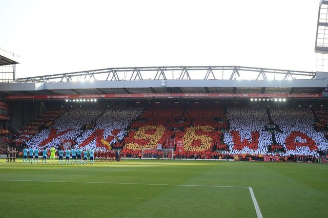 """Players observe a minute of applause and unveil a special """"96 mosaic"""" in the crowd to mark the 29th Anniversary of the Hillsborough tragedy in 2018."""