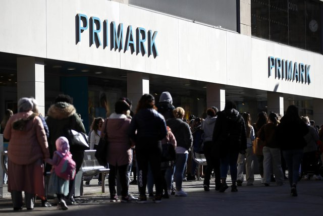 Shoppers queue outside Primark in Nottingham