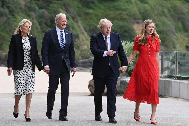 Boris Johnson and his wife Carrie Johnson walk together with U.S. President Joe Biden and First Lady Jill Biden  outside the Carbis Bay Hotel on June 10, 2021 in St Ives (WPA Pool/Getty Images)