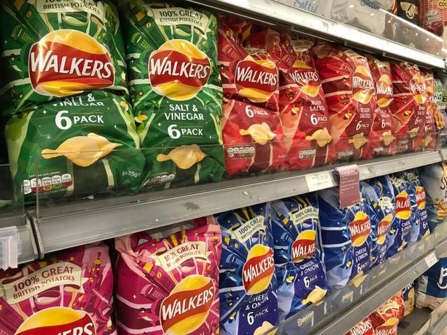 Packets of Walkers crisps on shelves in a supermarket (Shutterstock)