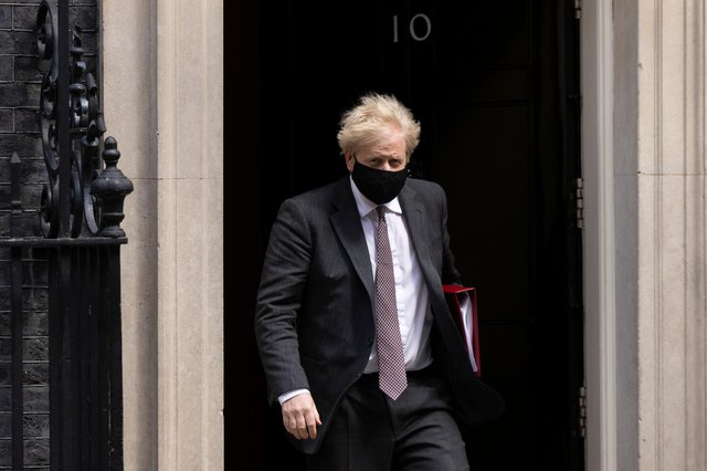 Prime Minister Boris Johnson leaves 10 Downing Street to attend the weekly Prime Ministers Questions in Parliament on April 21 (Photo by Dan Kitwood/Getty Images)