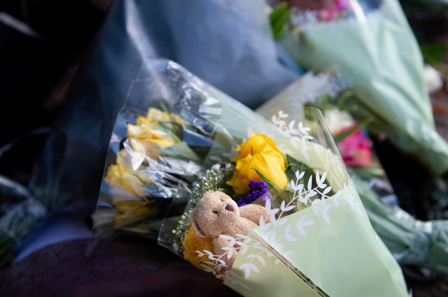Soft toys and flowers are left at the scene on High Street, Brownhills, near Walsall in the West Midlands, where a two-week-old baby boy in a pram was hit by a BMW car at around 4pm on Easter Sunday (Photo: PA/Jacob King)