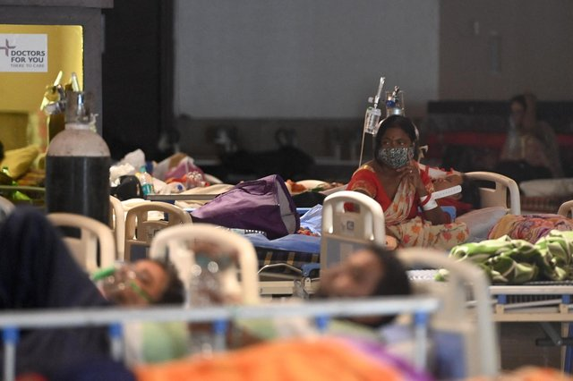 Patients rest inside a banquet hall temporarily converted into a Covid-19 coronavirus ward in New Delhi on April 27, 2021. (Money SHARMA / AFP/ Getty Images)