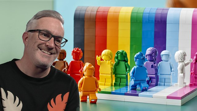 Designer and vice president of design for Lego, Matthew Ashton, with the company's new rainbow-themed 'Everyone is Awesome' set (Photo: LEGO/PA Media)