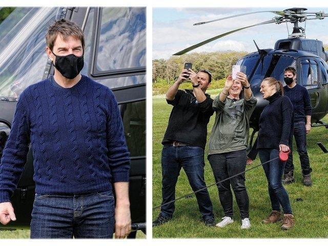 Tom Cruise beckoned fans over (Photo: Dave Burton)