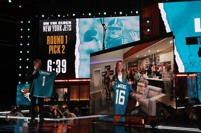 NFL Commissioner Roger Goodell announces the Jacksonville Jaguars selection of Trevor Lawrence with the first pick of the 2021 NFL Draft at the Great Lakes Science Center on April 29, 2021 in Cleveland, Ohio.