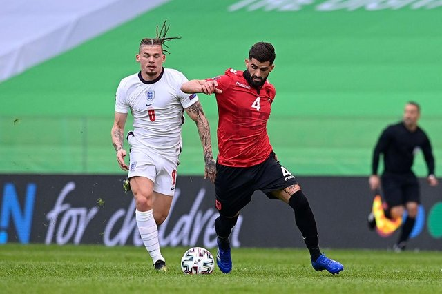 Kalvin Phillips of England battles for possession with Elseid Hysaj of Albania during the World Cup qualifying match at the Qemal Stafa Stadium in Tirana, Albania.