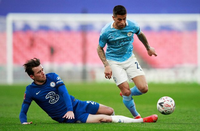 Ben Chilwell of Chelsea and Joao Cancelo of Manchester City  battle for the ball  during the Semi Final of the Emirates FA Cup match at Wembley Stadium on April 17, 2021 (Photo by Ian Walton - Pool/Getty Images)