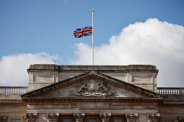 Union flags at royal residences and on government buildings were lowered to half-mast on Friday (Photo by TOLGA AKMEN/AFP via Getty Images)