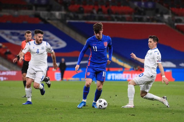 Mason Mount of England is challenged by Adolfo Hirsch of San Marino during the FIFA World Cup 2022 qualifying match.