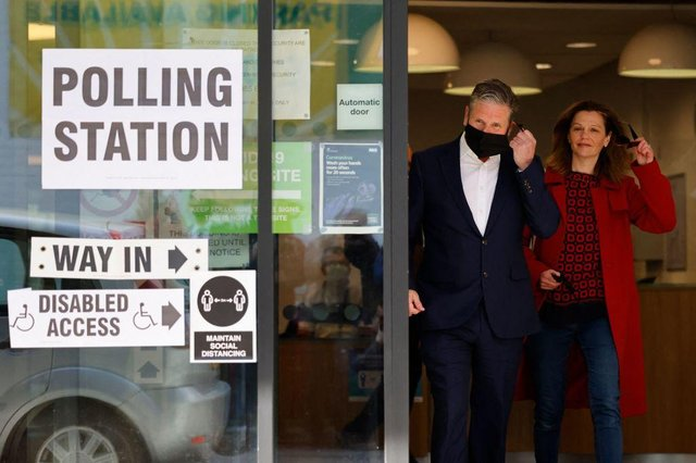 Labour party leader Keir Starmer and partner Victoria leave a polling station after casting their vote in local elections in London (Photo by Tolga Akmen / AFP)