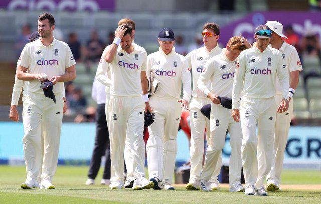 Dejected England players led by Joe Root make their way off the field following defeat against New Zealand at Edgbaston on June 13, 2021 in Birmingham, England. (Photo by Michael Steele/Getty Images)