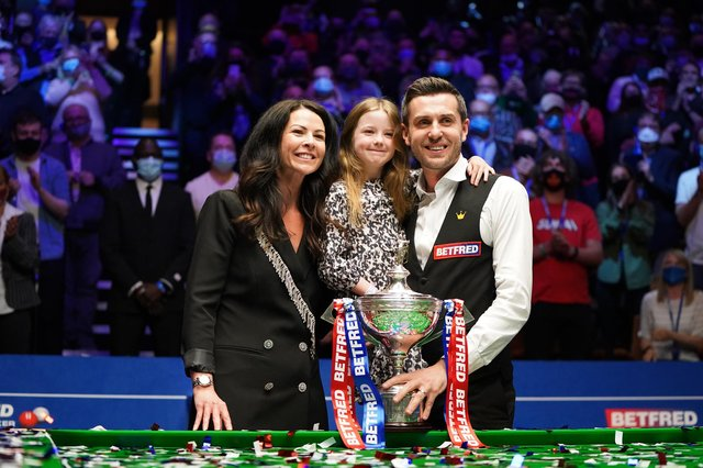 England's Mark Selby posses with his wife and daughter after winning the the Betfred World Snooker Championships 2021 at The Crucible, Sheffield.