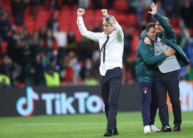 Italy's coach Roberto Mancini celebrates after winning the UEFA EURO 2020 semi-final football match between Italy and Spain at Wembley Stadium.