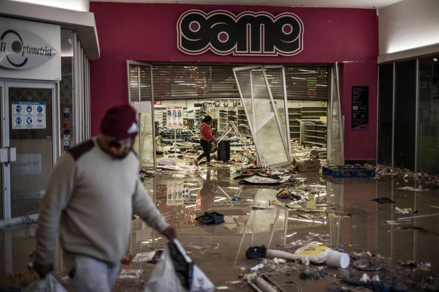 A mall in Vosloorus is left vandalised after raging unrest erupted when former president Jacob Zuma started serving a 15-month term for contempt  (AFP/Getty Images)