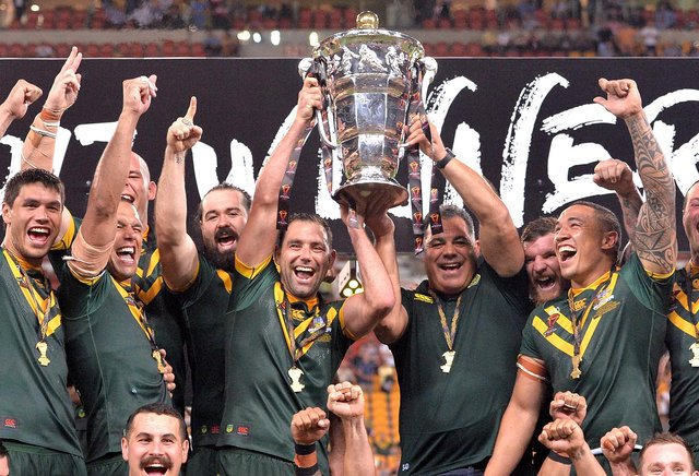 The Australian Kangaroos celebrate victory as captain Cameron Smith holds up the world cup trophy after the 2017 Rugby League World Cup Final between the Australian Kangaroos and England at Suncorp Stadium on December 2, 2017 in Brisbane, Australia. (Photo by Bradley Kanaris/Getty Images)