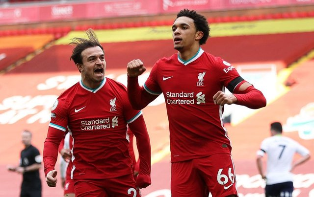 Trent Alexander-Arnold celebrates with Liverpool teammate Xherdan Shaqiri after keeping their Champions League bid intact with a last-gasp winner over Aston Villa.